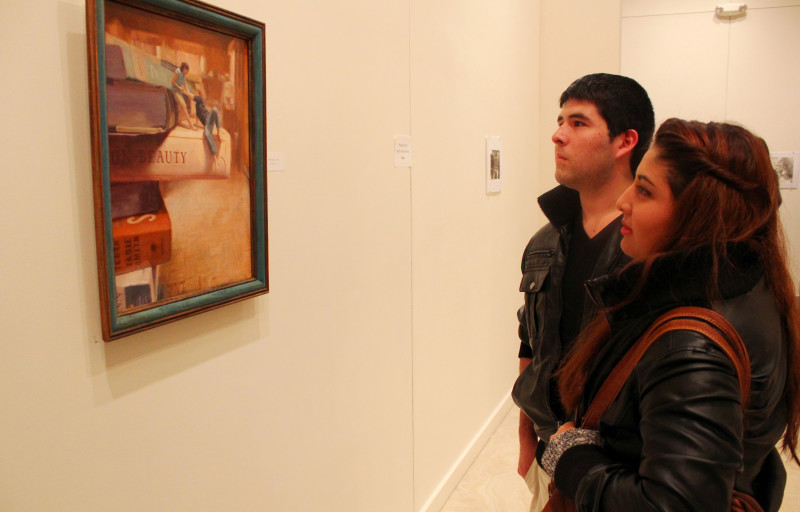 Students look at Cliffhangers painting during My Humble Existence Ricky Colson solo show